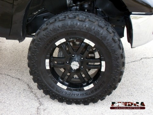 20 inch moto rims with 37x12.5 super swamper tires.