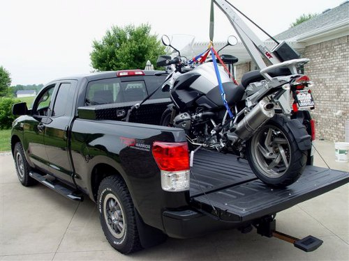 Tundra with Spitzlift crane holding BMW motorcycle